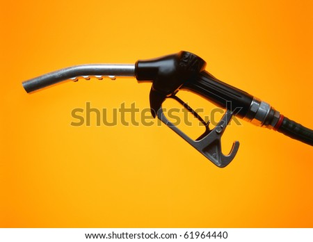 single gasoline pump on yellow background - stock photo