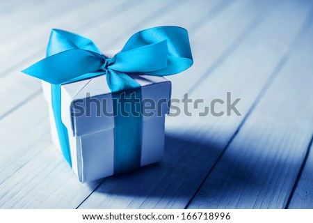 single gift box on wood table - stock photo