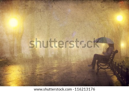 Single girl with umbrella sitting at the bench at night. Photo with noise and in old style image color. - stock photo