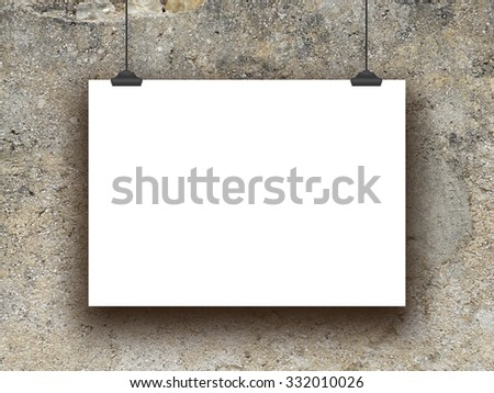 Single horizontal hanged paper sheet with clips on scratched old concrete wall background - stock photo