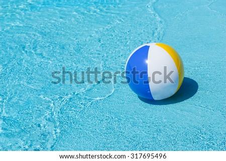 Pool Water With Beach Ball yellow white beach ball swimming pool stock photo 16044964
