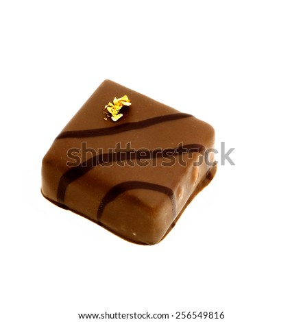 single isolated squared chocolate over white background - stock photo