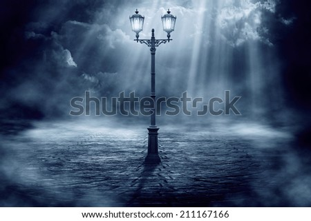 Single lantern on a background of a dramatic sky - stock photo