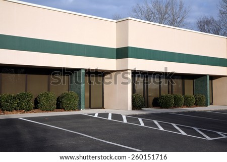 Single level offices with adjacent parking - stock photo