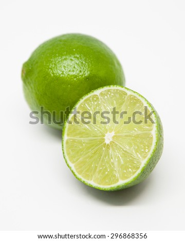 Single lime and half lime slice - stock photo