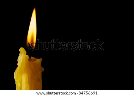 Single lit candle with quite flam - stock photo