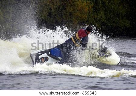 Single male jetskier, kingsbury water park, England, uk - stock photo