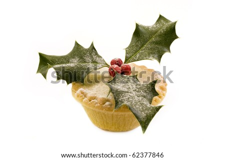 single mince pie decorated with holly over white - stock photo
