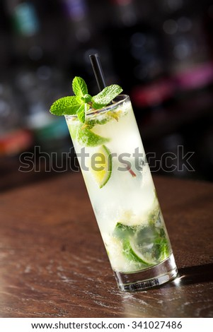 Single Mojito cocktail shot on a bar counter in a nightclub