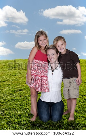 Single mom and her son and daughter - stock photo