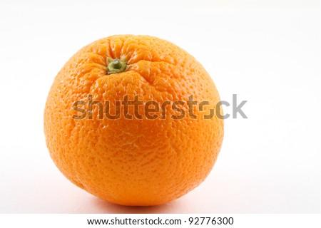 Single orange fruit on white - stock photo