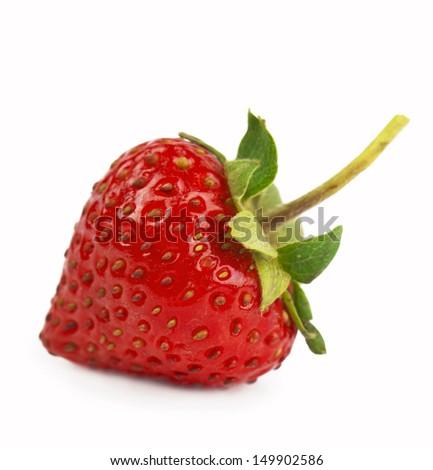 Single organic garden strawberry on white background - stock photo