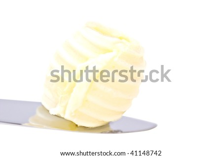 Single perfect butter curl on a knife with clipping path
