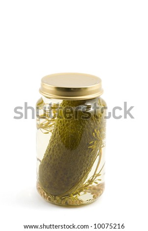 single pickled cucumber in a bottle, isolated on white