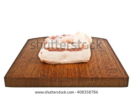 Single piece of fresh lard on cutting board