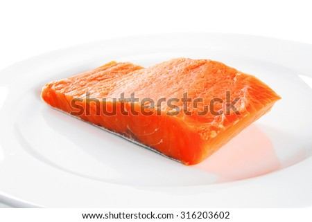 single pink salmon bit on a big white dish - stock photo
