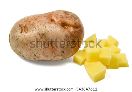Single potato with some diced one isolated on white