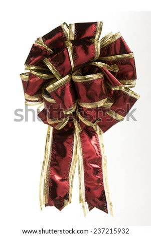single red and gold christmas bow over white - stock photo