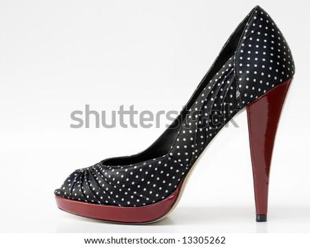 single red and polka dot high heel shoe - stock photo