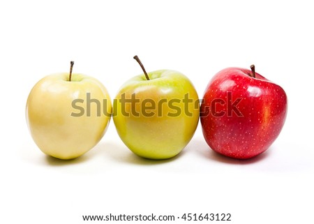 Single red apple, one green apple and one yellow apple. Juicy ripe fruits.  Isolated on white background. - stock photo