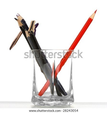 Single red crayon against dark and broken ones, standing out of the crowd concept, isolated over white - stock photo