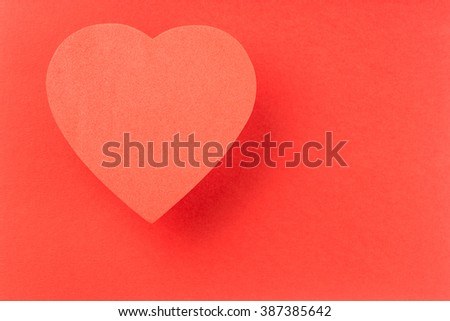 Single Red heart on red background