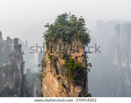 Single rock column mountain . Zhangjiajie National Forest Park was officially recognized as a UNESCO World Heritage Site - China   - stock photo
