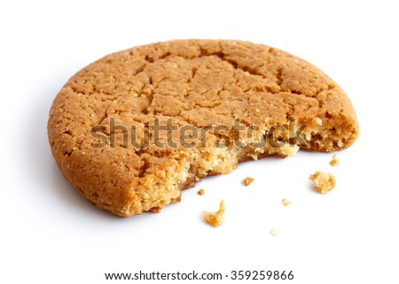 Single round ginger biscuit with crumbs and bite missing, isolated on white in perspective.