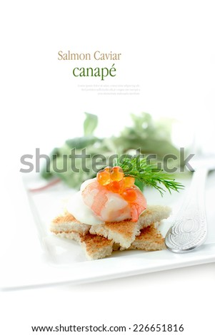Single salmon caviar canape against a white background. Copy space. - stock photo