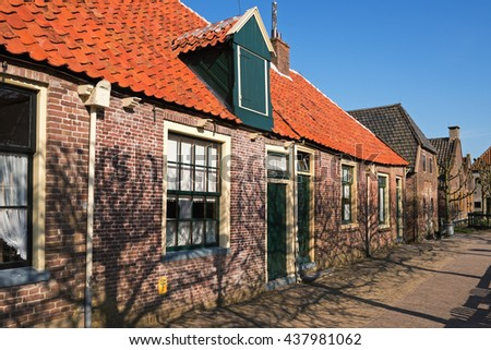 Single-storey dutch houses on the street of the  open-air museum in Enkhuizen, The Netherlands - stock photo