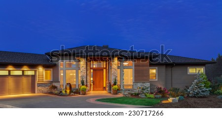 single story ranch style luxury home exterior at twilight - Luxury House Exterior