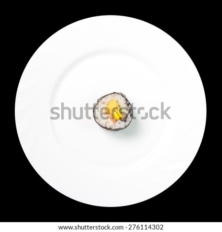 single sushi roll in middle of white plate - stock photo