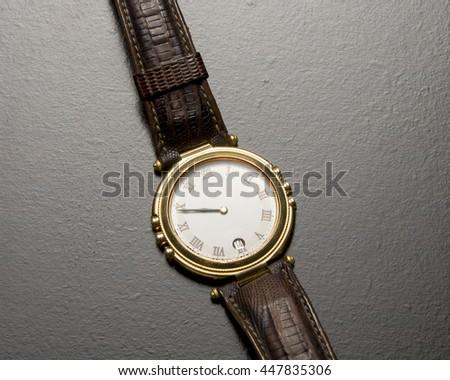 Single time piece/Wrist Watch/Luxury chronometer with worn bands - stock photo