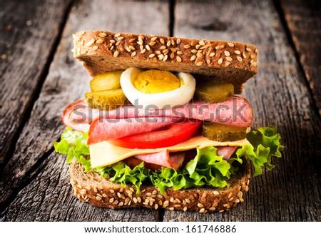 Single toast sandwich on the wooden background  - stock photo