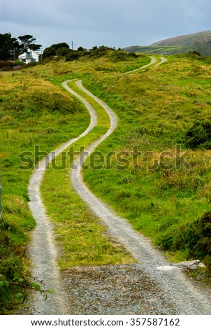 Single Track Gravel Road upon a Hill - stock photo