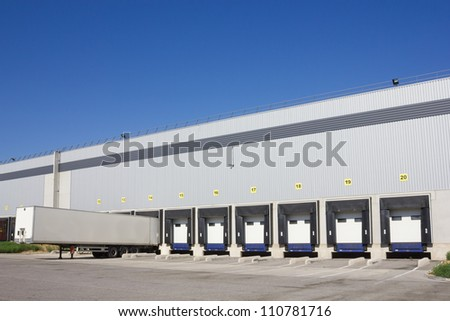 Single trailer at the loading docks - stock photo