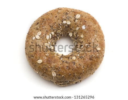 Single twelve grain bagel isolated on white. - stock photo