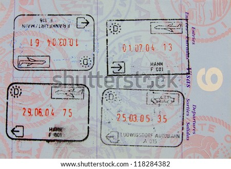 Single vivid passport page with four stamps - stock photo