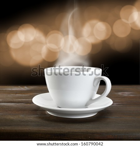 single white cup and brown table with bokeh space  - stock photo