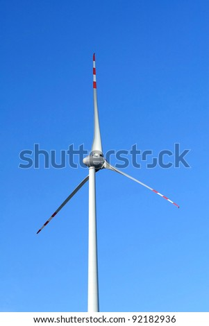 Single wind turbine on blue sky