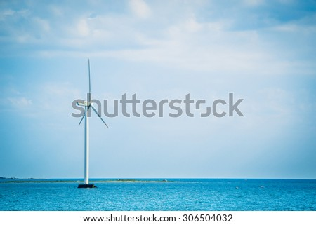 Single windmill in the oceran by the coast