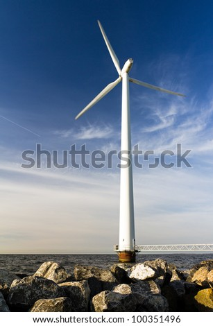 Single windmill on the rocks