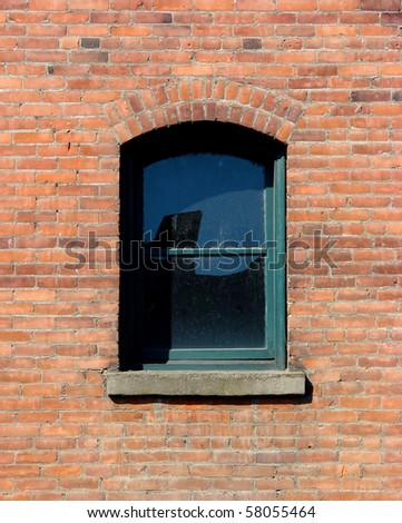single window on brick building wall - stock photo
