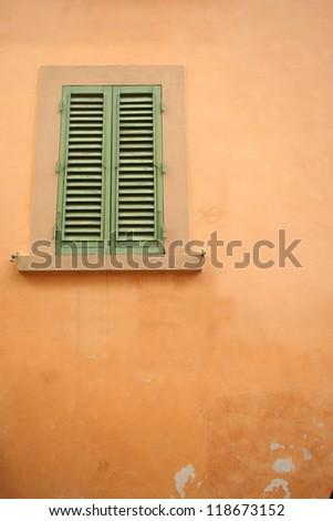 Single Window on Stucco Wall - stock photo