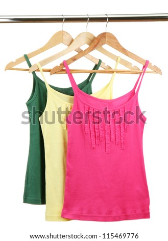 singlets on wooden hangers, isolated on white