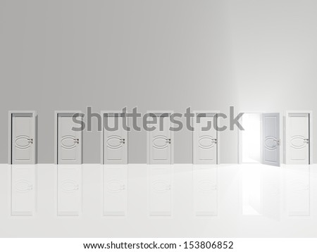Sinigle open doo remits light  in huge white wall in white space - stock photo