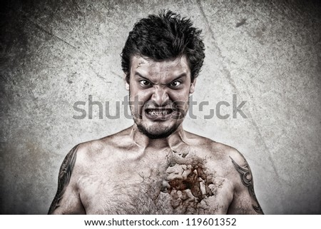 Sinister face with cracked skin - stock photo