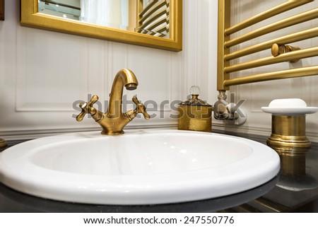 Sink close up in bathroom interior - stock photo