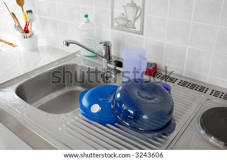 Sink for washing dishes in a kitchen - stock photo