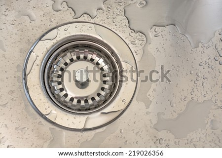 sink hole in a metal sink - stock photo